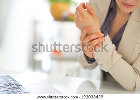 Closeup on business woman with wrist pain - stock photo