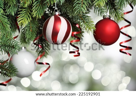 Closeup on Christmas tree decoration over festive background - stock photo