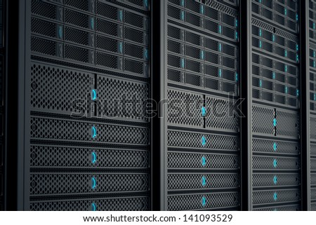Closeup on data servers while working. Blue LED lights are flashing. Image can represent cloud computing, information storage, etc. or can be the perfect technology background. - stock photo