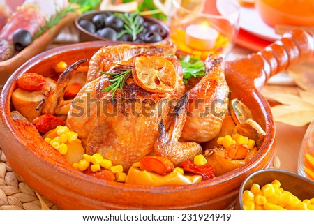 Closeup on delicious prepared Thanksgiving turkey baked with vegetables, traditional American autumn holiday, festive dinner at home concept - stock photo
