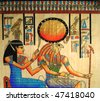 Closeup on egyptian papyrus with Horus and queen - stock photo