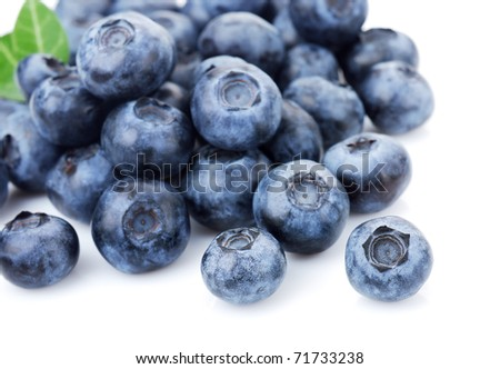 Closeup on fresh blueberries isolated on white background. Selective focus. - stock photo