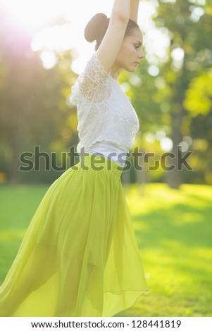 Closeup on girl dancing on meadow - stock photo