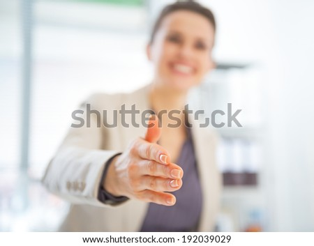 Closeup on happy business woman stretching hand for handshake - stock photo