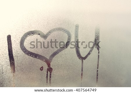 Closeup on I love you sign on glass - stock photo