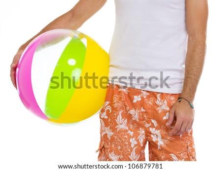 Closeup on male holding beach ball - stock photo
