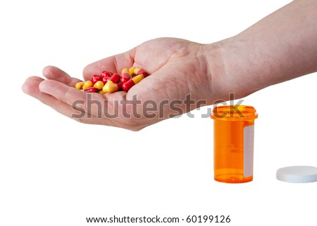 Closeup on man's hand with pills and pill container. - stock photo