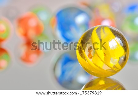 Closeup on many colorful glass marbles - stock photo