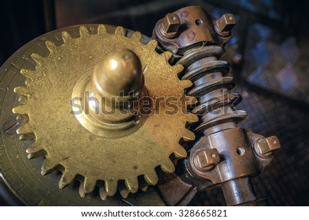 Closeup on mechanical gear wheels and old industrial machine parts. - stock photo