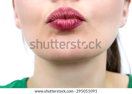 Closeup on mouth of females face, sending a kiss - stock photo