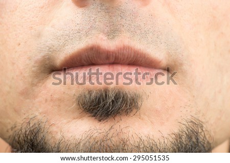 Closeup on mouth of males face - stock photo