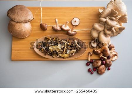 Closeup on mushrooms on cutting board - stock photo