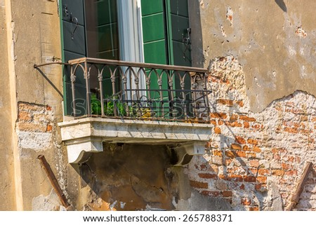 Closeup on old window of a typical Venetian house, Italy - stock photo