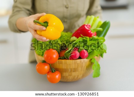Closeup on plate with vegetables forming by housewife in kitchen