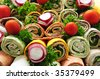 Closeup on platter of assorted meat tortilla wraps - stock photo