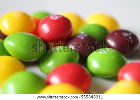 Closeup on round colorfull sugar candies. Multicolored sweet. Halloween treats.