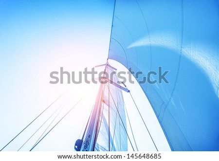 Closeup on sail on blue sky background, active lifestyle, cruise of dream, extreme water sport, summer holidays, yachting concept - stock photo