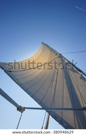 Closeup on sail on blue sky background, active lifestyle,  summer holidays