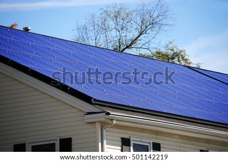 closeup on solar panel installed on house roof