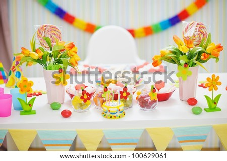 Closeup on table decorated for children's celebration party - stock photo