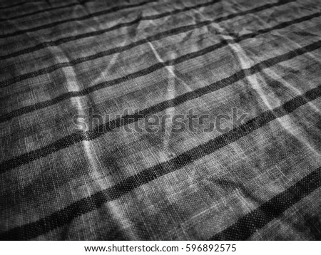 Closeup on texture of natural linen fabric background