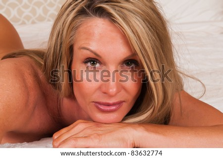 Closeup on the face of a beautiful mature blonde - stock photo
