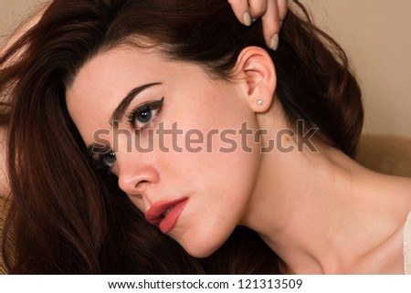 Closeup on the face of a pretty young redhead - stock photo