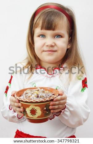 Closeup on traditional Christmas kutia dish. Girl holding kutyu - stock photo
