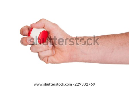 Closeup on white background of male hand with a red and white ball - stock photo