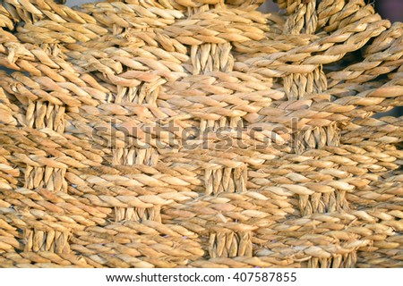 Closeup on wicker weave texture, straw reed macro background - stock photo