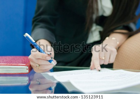 closeup on woman hand write by pen - stock photo