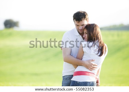 Closeup on young beautiful couple in love - stock photo