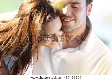Closeup on young beautiful smiling couple. - stock photo