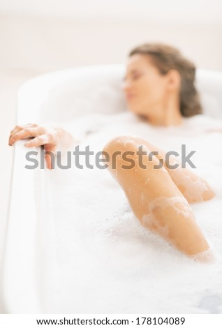 Closeup on young woman laying in bathtub