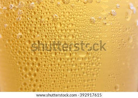 Closeup Orange beer and white froth background. - stock photo