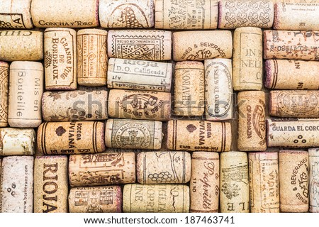 Closeup pattern background of many different wine corks with dates and drops of wine - stock photo