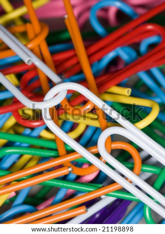 closeup pattern of colored paperclips