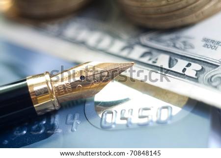closeup pen, credit card and money - stock photo