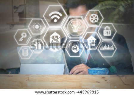 closeup photo blurred of Businessman working on the workplace beside window glass over the Social media symbol on Internet network concept background, Business technology concept - stock photo