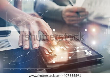 Closeup photo female hands touching screen modern tablet. Account managers working new investment project in office. Using electronic devices. Graphics icons, worldwide stock exchanges interface.  - stock photo