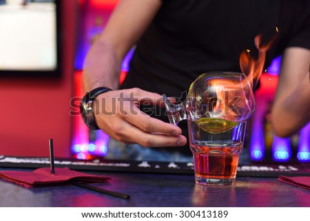 Closeup photo in a bar where barmen makes cocktail - stock photo