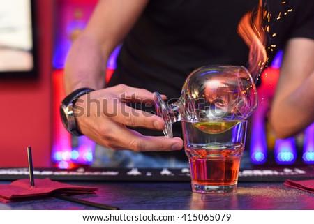 Closeup photo in a bar where barmen makes cocktail - stock photo
