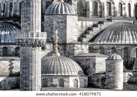 Closeup photo of a beautiful Blue Mosque background, details of an exterior of an ancient architectural masterpiece, black and white photo, Istanbul, Turkey - stock photo