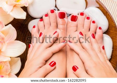 Closeup photo of a beautiful female feet at spa salon on pedicure procedure - stock photo