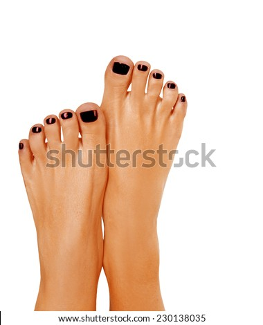 Closeup photo of a beautiful female feet with black pedicure, dark skin with tanning. Isolated on white background - stock photo