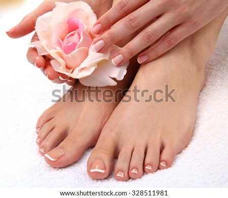 Closeup photo of a beautiful female feet with pedicure. - stock photo
