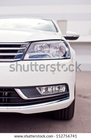 Closeup photo of a black car's headlight - stock photo