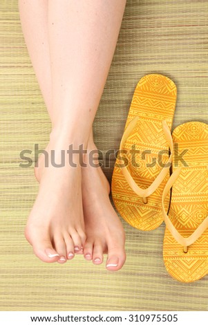 Closeup photo of a female feet at spa salon on pedicure procedure