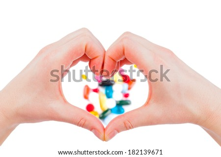 Closeup photo of a hand shaping a heart  - stock photo