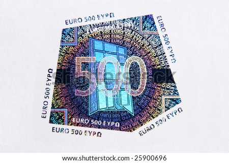 Closeup photo of a hologram of  five hundred euro note. Macro photo. - stock photo